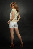 Portrait of young blonde, full body from back Royalty Free Stock Image