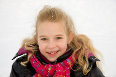 Portrait of young blonde girl looking in camera Stock Images