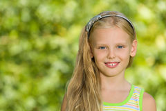 Portrait of a young blonde girl outdoors Royalty Free Stock Photography