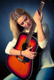Portrait of young blonde guitar player woman Royalty Free Stock Photography