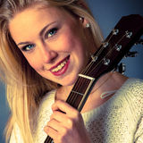 Portrait of young blonde guitar player woman Stock Image