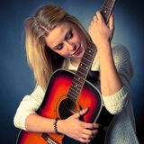 Portrait of young blonde guitar player woman Stock Photos
