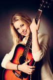 Portrait of young blonde guitar player woman Royalty Free Stock Photo