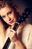 Portrait of young blonde guitar player woman Royalty Free Stock Images