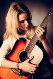 Portrait of young blonde guitar player woman Stock Images