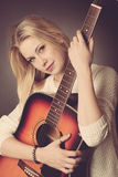Portrait of young blonde guitar player woman Stock Photo