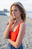 Portrait of young blonde hair charming woman standing alone on the beach waiting for someone Royalty Free Stock Photos