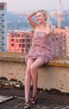 Portrait of a young blonde lady. On the roof Royalty Free Stock Image