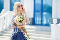 Portrait of a young blonde with a mobile phone Royalty Free Stock Images