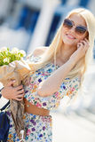 Portrait of a young blonde with a mobile phone Stock Image