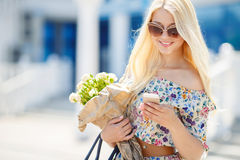 Portrait of a young blonde with a mobile phone Royalty Free Stock Photography