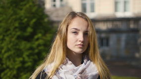 Portrait of a Young Blonde Serious Girl stock footage