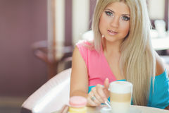 Portrait of a young blonde, sitting in a cafe Stock Photo