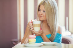 Portrait of a young blonde, sitting in a cafe Stock Photos