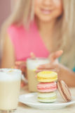 Portrait of a young blonde, sitting in a cafe Royalty Free Stock Image