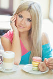 Portrait of a young blonde, sitting in a cafe Royalty Free Stock Photos