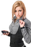 Portrait of young blonde with smartphone. Isolated Stock Photo
