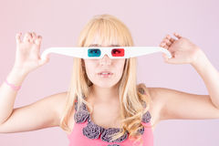 Portrait of a young, blonde woman, with 3d glasses Royalty Free Stock Photos