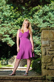 Portrait of young blonde woman fuchsia dress Royalty Free Stock Photo