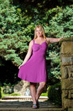 Portrait of young blonde woman fuchsia dress Royalty Free Stock Images