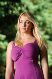 Portrait of young blonde woman fuchsia dress Stock Image