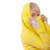 Portrait of young blonde. Woman hides face behind yellow yashmak, is  on white background Royalty Free Stock Photos