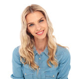 Portrait of a young blonde woman in jeans shirt smiling Stock Photos
