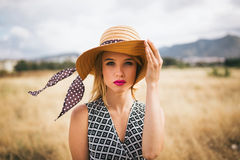 Portrait of young blonde woman in nature Stock Photo