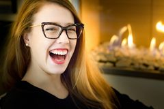 Portrait of a young blonde woman wearing eyeglasses, laughing, i Stock Image