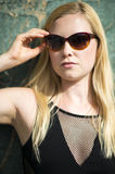 Portrait of young blonde woman wearing sunglasses. Posing Royalty Free Stock Photo