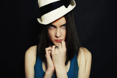 Portrait of young blue-eyed girl in white hat Royalty Free Stock Photos