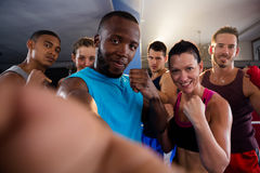 Portrait of young boxers standing in fighting stance. At fitness studio Stock Photography