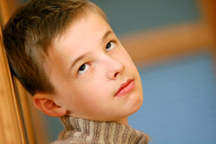Portrait of young boy. Thinking Stock Image