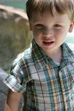 Portrait of young boy. In checkered shirt Stock Photography