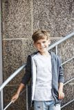Portrait of a young boy against brick wall Stock Photos