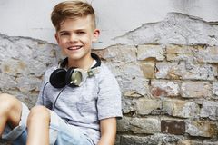 Portrait of a young boy against brick wall Royalty Free Stock Images