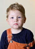 Portrait of a young boy in dirty clothes looking directly at camera Royalty Free Stock Images