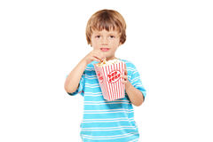 Portrait of a young boy eating popcorn Stock Photo
