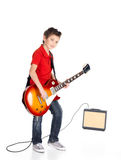 Portrait of young boy with a electric guitar Royalty Free Stock Photography