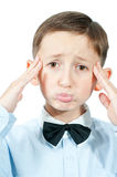 Portrait of  young  boy. Emotional portrait of discontent  young boy over white background Royalty Free Stock Images