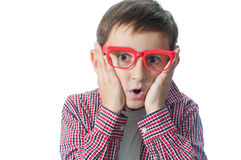 Portrait of  young  boy. Emotional portrait of surprised young boy over white background Stock Photo