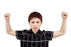 Portrait of a young boy with hand raised up Royalty Free Stock Image