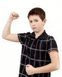 Portrait of a young boy with hand raised up and showing muscles Stock Photography