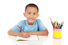Portrait of young boy happily studying Royalty Free Stock Photo