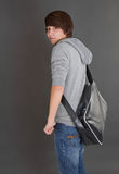 Portrait of young boy with his bag. Royalty Free Stock Images