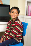 Portrait of a Young Boy. At his Work Desk Royalty Free Stock Photography