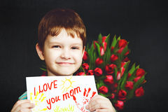 Portrait young boy holding a piece of paper. Royalty Free Stock Photos