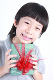 Portrait of young boy holding a present Royalty Free Stock Images