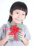 Portrait of young boy holding a present Stock Images