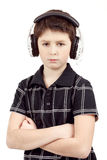 Portrait of a young boy listening to music on head Royalty Free Stock Photos